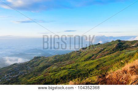 Sea Of Fog Over Mountain At Sunrise
