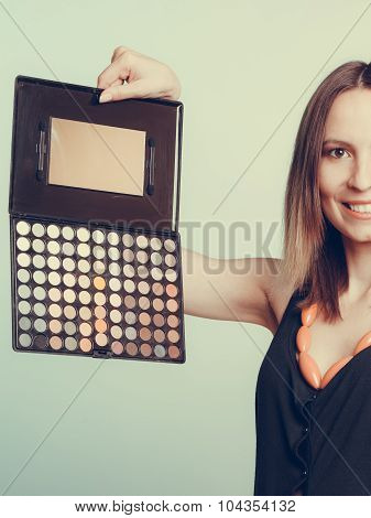 Woman Stylist Holding Eyeshadow Makeup Palette.