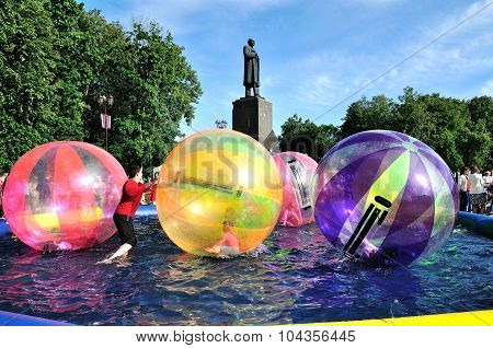 Unidentified Kids Zorb Inside Large Air Balls On Water In The Pool In Veliky Novgorod, Russia