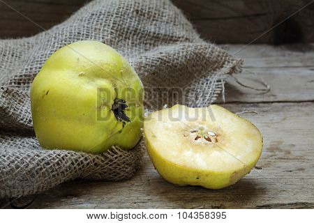 Portugal Quince Or Pear Quince (cydonia Oblonga) On Rustic Wood