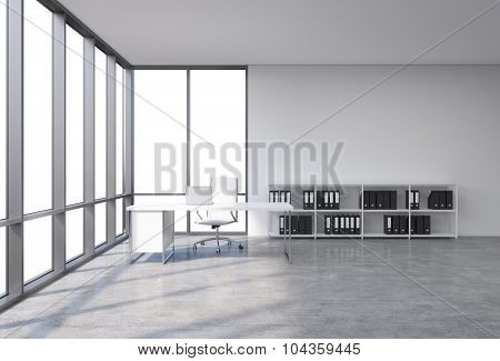 A Workplace In A Modern Corner Panoramic Office With Copy Space In The Windows. A White Desk With A