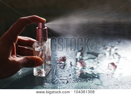 Perfume bottle with water drops