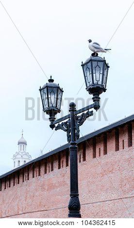 Metal Lantern With Gull On It On The Background Of Novgorod Kremlin In Veliky Novgorod