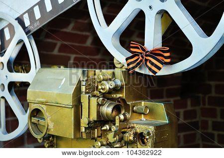 Old Film Cinema Camera In The Span Of Novgorod Kremlin Fortress.