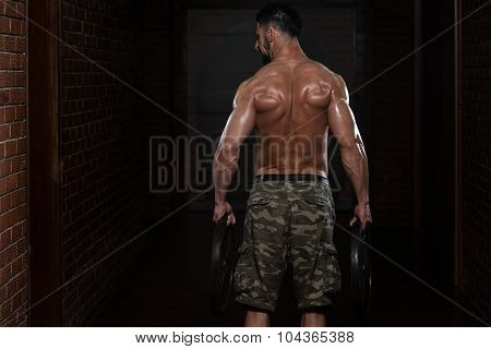Athlete Doing Heavy Weight Exercise For Trapezius