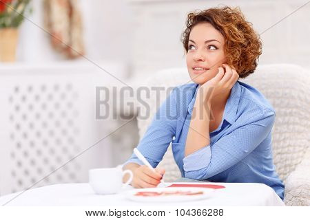 Nice girl sitting at the table