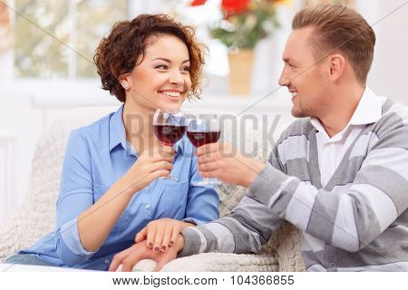 Loving couple sitting at the table