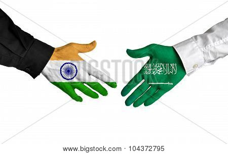 India and Saudi Arabia leaders shaking hands on a deal agreement