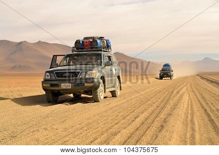Tourist jeeps in the desert of Southwestern Bolivia near Uyuni