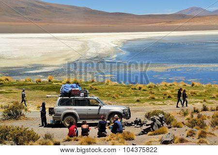 Tourist Jeep stops at Laguna Verde in Southwestern Bolivia near Uyuni