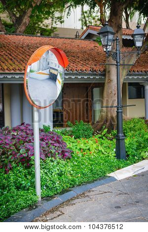 Convex Traffic Mirror Mounted On A Residential Street