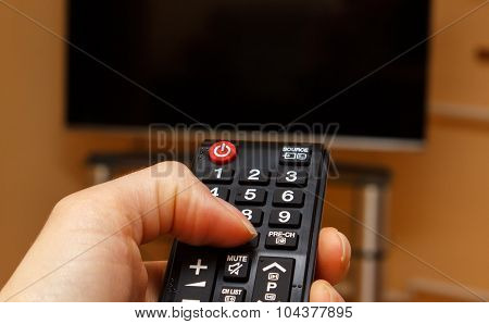 Hand Holding Remote Control For Television, Choosing Channel In Tv