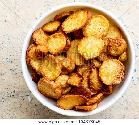 Fried colocasia vegetable kept in a serving bowl on a plain background