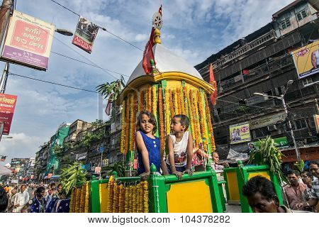 Two Smiling Girls Riding Lord Jagannath Chariot.