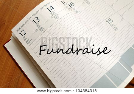 Fundraise write on notebook