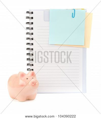 Copybook with stickers and piggy bank