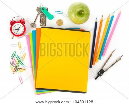 Copybooks with alarm clock and office stuff