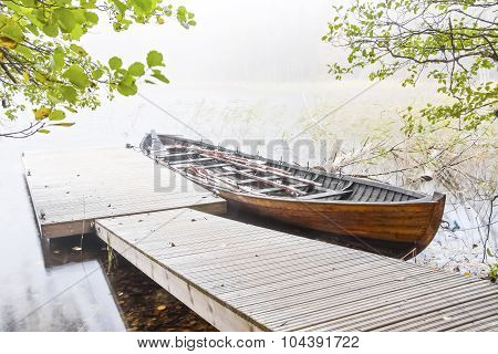 Long Wood Boat In A Mist