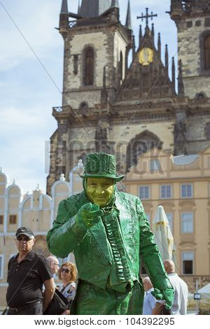 Green meme posing on old Town Square
