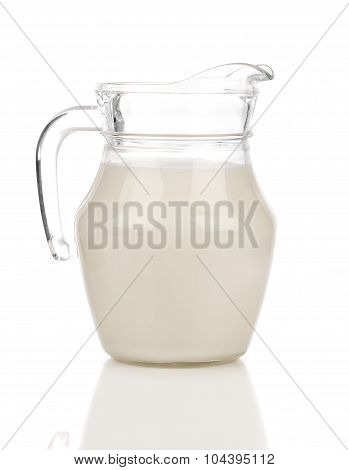 Pitcher Of Milk On A White Background