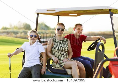 Family Portrait In A Cart At The Golf Course