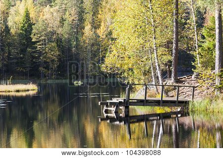 Bridge In A Lake In Colorful Autumn Forest