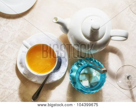 Hippophae tea and tea set on a table in a restaurant
