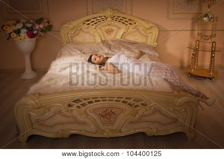 Elegant Girl In Evening Dress In An Elegant Bedroom