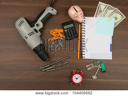 Drill with money and piggy bank