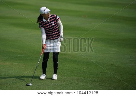 KUALA LUMPUR, MALAYSIA - OCTOBER 09, 2015: Japan's Sakura Yokomine checks the sixth hole fairway of the KL Golf & Country Club at the 2015 Sime Darby LPGA Malaysia golf tournament.