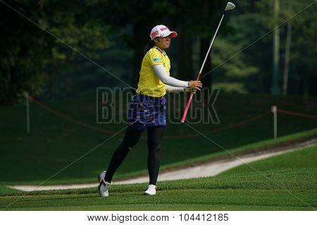 KUALA LUMPUR, MALAYSIA - OCTOBER 09, 2015: Thailand's Pornapong Phatlum plays from 6th hole fairway of the Kuala Lumpur Golf & Country Club at the 2015 Sime Darby LPGA Malaysia golf tournament.