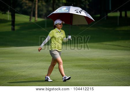 KUALA LUMPUR, MALAYSIA - OCTOBER 09, 2015: Japan's Mika Miyazato walks on the fairway of the Kuala Lumpur Golf & Country Club at the 2015 Sime Darby LPGA Malaysia golf tournament.