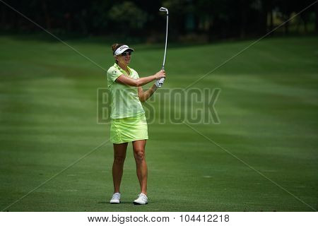 KUALA LUMPUR, MALAYSIA - OCTOBER 09, 2015: USA Brittany Lang plays from 6th hole fairway of the Kuala Lumpur Golf & Country Club at the 2015 Sime Darby LPGA Malaysia golf tournament.