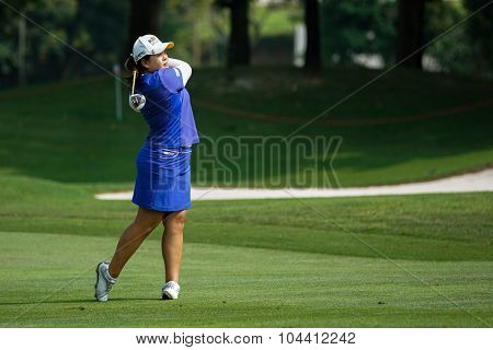 KUALA LUMPUR, MALAYSIA - OCTOBER 09, 2015: South Korea's Inbee Park plays on the fairway of the Kuala Lumpur Golf & Country Club at the 2015 Sime Darby LPGA Malaysia golf tournament.