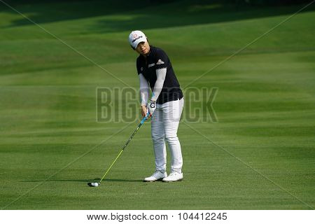 KUALA LUMPUR, MALAYSIA - OCTOBER 09, 2015: South Korea's Eun-Hee Ji prepares to hit from fairway of the 6th hole at the KL Golf & Country Club at the 2015 Sime Darby LPGA Malaysia golf tournament.