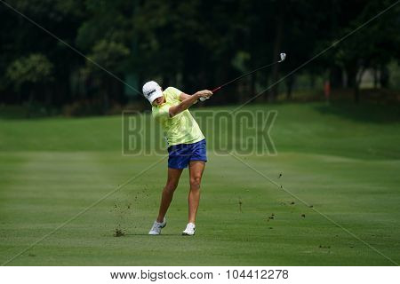 KUALA LUMPUR, MALAYSIA - OCTOBER 09, 2015: USA's Stacy Lewis plays her shot on the sixth hole fairway of the KL Golf & Country Club at the 2015 Sime Darby LPGA Malaysia golf tournament.