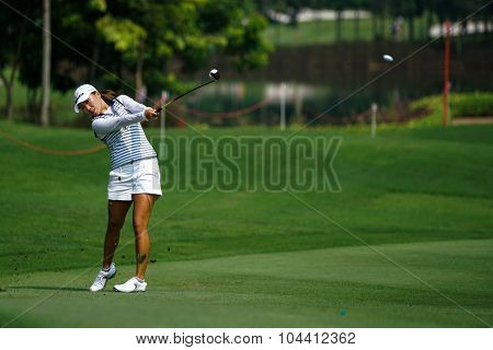 KUALA LUMPUR, MALAYSIA - OCTOBER 09, 2015: South Korea's I. K. Kim plays from 6th hole fairway of the Kuala Lumpur Golf & Country Club at the 2015 Sime Darby LPGA Malaysia golf tournament.
