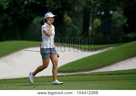 KUALA LUMPUR, MALAYSIA - OCTOBER 09, 2015: New Zealand's Lydia Ko walks on the sixth hole fairway of the Kuala Lumpur Golf & Country Club at the 2015 Sime Darby LPGA Malaysia golf tournament.