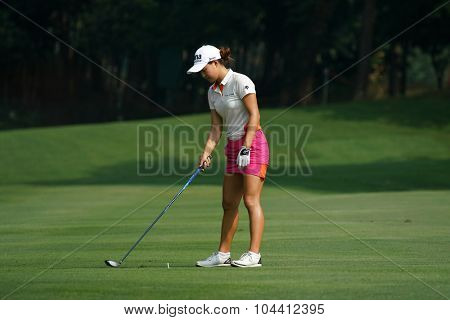 KUALA LUMPUR, MALAYSIA - OCTOBER 09, 2015: Australia's Minjee Lee prepares to hit from 6th hole fairway at the KL and Golf & Country Club at the 2015 Sime Darby LPGA Malaysia golf tournament.
