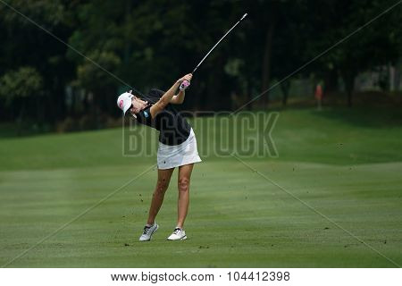 KUALA LUMPUR, MALAYSIA - OCTOBER 09, 2015: USA's Paula Creamer plays from the fairway of the sixth hole of the Kuala Lumpur Golf & Country Club at the 2015 Sime Darby LPGA Malaysia golf tournament.