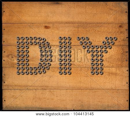 Diy Symbol - Screws On Wooden Background