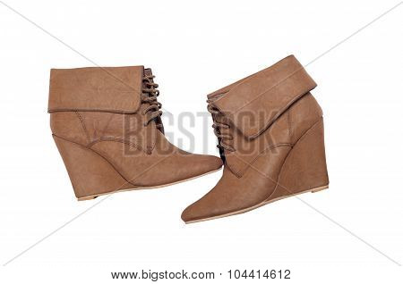 Brown ankle women boots isolated on white background.