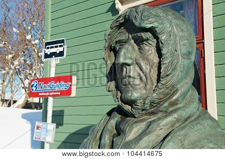 Polar explorer Roald Amundsen bust in front of the Polar museum building in Tromso, Norway.