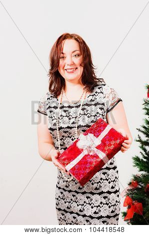 Smiling woman holding red  box