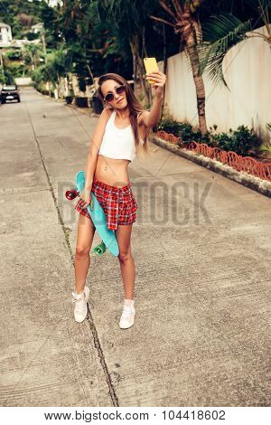 Beautiful Sexy Young Lady In Erotic Mini Skirt With A Skateboard In The Street