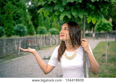 Girl Hiding From The Rain Under A Tree