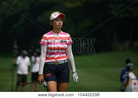 KUALA LUMPUR, MALAYSIA - OCTOBER 09, 2015: South Korea's Chella Choi reacts after her shot at the 6th hole fairway at the KL Golf & Country Club at the 2015 Sime Darby LPGA Malaysia golf tournament.