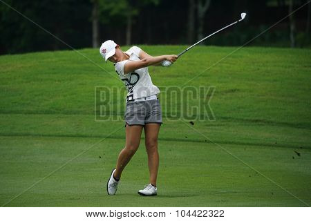 KUALA LUMPUR, MALAYSIA - OCTOBER 09, 2015: South Korea's Min Lee plays from the 6th hole fairway at the KL Golf & Country Club at the 2015 Sime Darby LPGA Malaysia golf tournament.