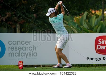 KUALA LUMPUR, MALAYSIA - OCTOBER 09, 2015: France's Karine Ischer prepares to tee off from the 4th hole at the KL Golf & Country Club at the 2015 Sime Darby LPGA Malaysia golf tournament.