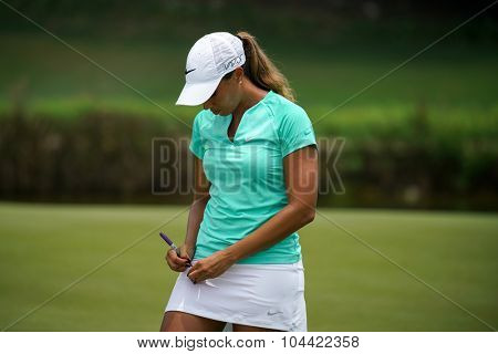 KUALA LUMPUR, MALAYSIA - OCTOBER 09, 2015: USA's Cheyenne Woods autographs a golf ball after doing her day's play at the KL Golf & Country Club at the 2015 Sime Darby LPGA Malaysia golf tournament.